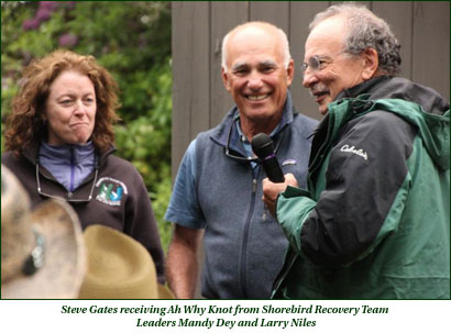 Steve Gates receiving Ah Why Knot from Shorebird Recovery Team Leaders Mandy Dey and Larry Niles
