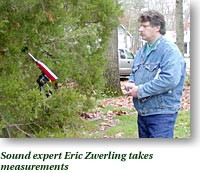 Sound expert Eric Zwerling takes measurements