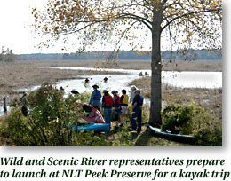 Wild and Scenic River representatives prepare to launch at NLT Peek Preserve for a kayak trip
