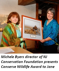 Michele Byers, director of NJ Conservation Foundation, presents Conserve Wildlife Award to Jane