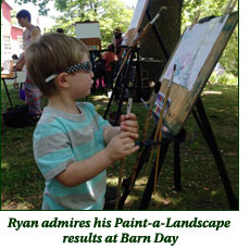Ryan admires is Paint-a-Landscape results at Barn Day
