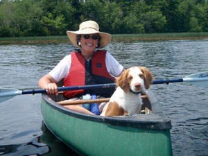 Jane and dog in a canoe