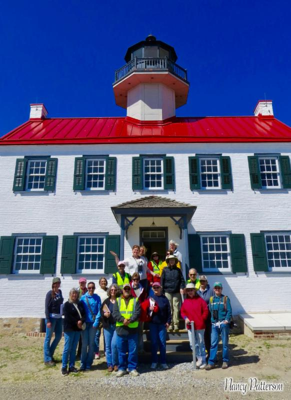 CU ReTurn the Favor volunteers pose on the steps of East Point Lighthouse
