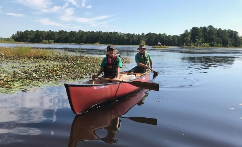 Sarah and Fred look for dragonfly larve on Cumberland Pond.