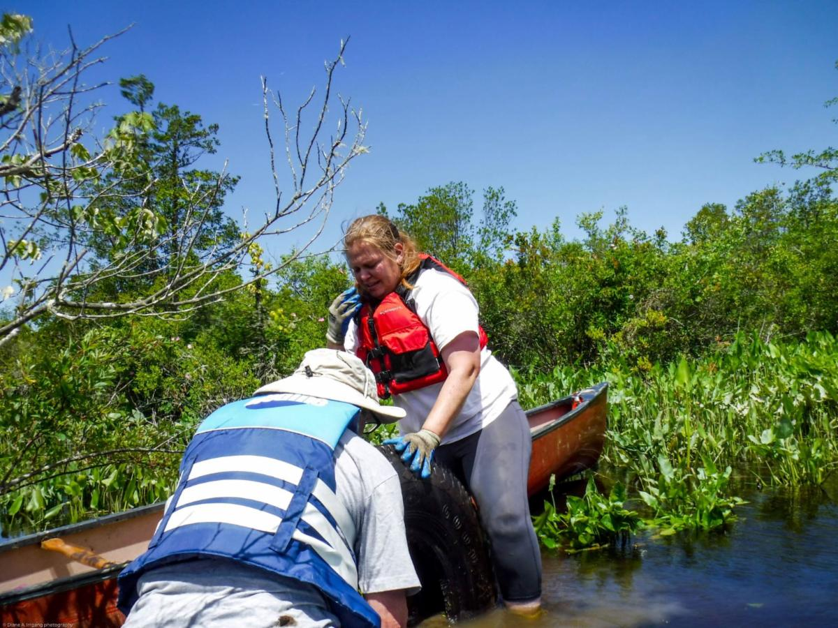 Karla Rossini and Tom Glynn remove a tire from the Wild and Scenic Maurice River at the volunteer work group held on June 11th.